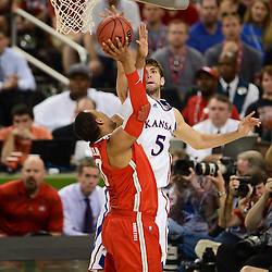 Mar 31, 2012; New Orleans, LA, USA; Ohio State Buckeyes forward Jared Sullinger (0) goes up for a shot as Kansas Jayhawks center Jeff Withey (5) defends during the second half in the semifinals of the 2012 NCAA men's basketball Final Four at the Mercedes-Benz Superdome. Mandatory Credit: Derick E. Hingle-US PRESSWIRE