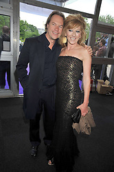 KELLY HOPPEN and JOHN HITCHCOX at The Butterfly Ball in aid of the Caudwell Children Charity held in Battersea park, London on 14th May 2009.