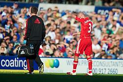 BIRMINGHAM, ENGLAND - Sunday, September 12, 2010: Liverpool's Paul Konchesky walks off injured during the Premiership match against Birmingham City at St Andrews. (Photo by David Rawcliffe/Propaganda)