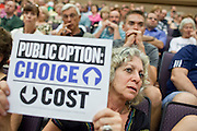 Aug 26, 2009 -- PHOENIX, AZ: SHELLY BERGER DOOLEY, from Phoenix, holds up a sign supporting the public option during a town hall meeting on health care reform sponsored by Sen John McCain at North Phoenix Baptist Church in Phoenix, AZ, Wednesday. Sen McCain hosted his second town hall meeting on health care in two days Wednesday. About 1,000 people attended the meeting. Although most were opposed to President Obama's health care proposals and supported Sen McCain, there was a large group who support the President's health care efforts.  Photo by Jack Kurtz