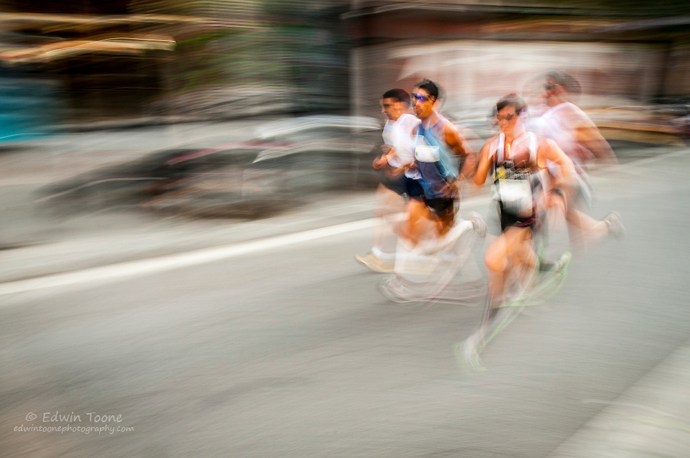 A group of four runners take the lead in the annual 10k race, Cros Popular de Sants.