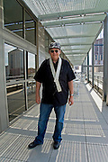 Tommy Shannon at the Austin Convention Center after speaking on a panel during South by Southwest 2009, Austin Texas, March 22, 2009.  Tommy Shannon (1946-) is an American bass guitarist best known as a member of Stevie Ray Vaughan & Double Trouble, the ARC Angels, and Storyville. In this photo, Shannon is wearing a guitar strap made for him by Stevie Ray Vaughan.