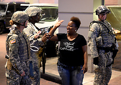September 23, 2016 - Charlotte, NC, USA - An activist high-fives members of the National Guard in Charlotte, N.C., on Friday, Sept. 23, 2016, as demonstrations continue following the shooting death of Keith Scott by police earlier in the week. (Credit Image: © Jeff Siner/TNS via ZUMA Wire)