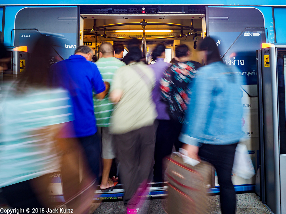 06 DECEMBER 2018 - SAMUT PRAKAN, THAILAND: Passengers board a train on the expansion of  BTS Skytrain in Samrong station. The 12.6 kilometer (7.8 miles) east extension of the Sukhumvit Line of the Bangkok BTS Skytrain goes into Samut Prakan, a town east of Bangkok.  The system is now 51 kilometers long (32 miles), including the 12.6 kilometer extension that opened December 06. About 900,000 people per day use the BTS.      PHOTO BY JACK KURTZ