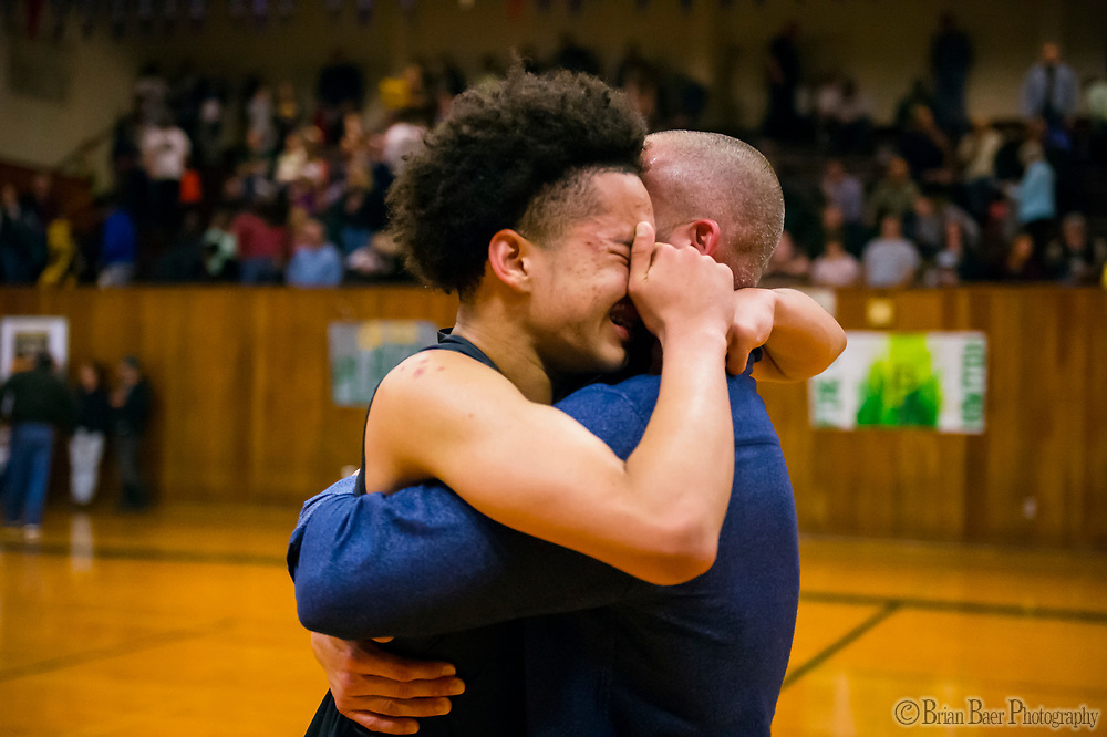 Liberty Ranch Hawks Jalen Patterson (2), cries as he hugs head coach Josh Williams after defeating the Placer Hillman 85-80 in the DIV NorCal boys quarterfinal, Saturday Mar 10, 2018.  <br /> photo by Brian Baer