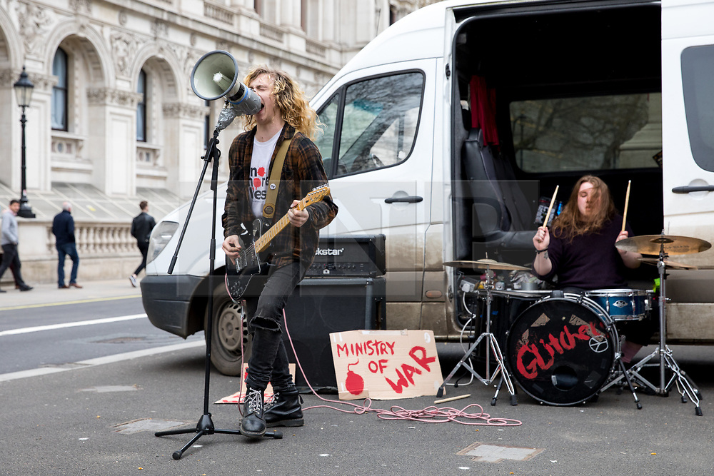 © Licensed to London News Pictures. 15/04/2018. London, UK. A punk rock band who are protesting against the government perform an impromptu gig from the back of their van, under the Cenotaph on Whitehall. The police allowed them to play four songs until they were forced to pack up and move on. Photo credit : Tom Nicholson/LNP