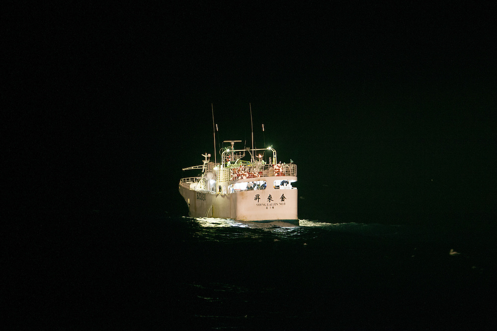 An Asian longliner fishing at the EEZ boundaries of Madagascar and the Seychelles is caught in the spotlight of a patrol vessel.  This longliner was licensed, but Illegal, Unregulated and Unreported (IUU) fishing by industrial vessels in Malagasy waters over the last two decades has caused untold and irreparable damage.  IUU longliners targeted sharks for their high value fins and liver oil. With only three patrol vessels, 24 inspectors and little money, Madagascar does not have the means to patrol its EEZ of over one million square kilometres.  This joint patrol between Madagascar, the Seychelles and Mauritius was financed by the EU.