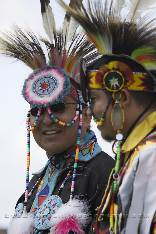 Native American males dancing at ceremonial Pow Wow at Browning , Montana