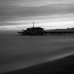 Santa Monica Pier sunset black and white panoramic photo along the Pacific Ocean in Southern California. Panorama photo ratio is 1:3. Copyright ⓒ 2017 Paul Velgos with All Rights Reserved.