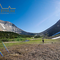 preston park woman hiking toward siyeh pass glacier national park