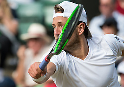 LONDON, ENGLAND - Wednesday, July 6, 2016:   Lucas Pouille (FRA) during the Gentlemen's Single Quarter Final match on day ten of the Wimbledon Lawn Tennis Championships at the All England Lawn Tennis and Croquet Club. (Pic by Kirsten Holst/Propaganda)