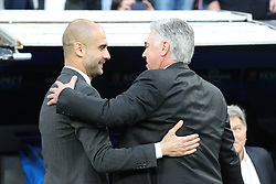 23.04.2014, Estadio Santiago Bernabeu, Madrid, ESP, UEFA CL, Real Madrid vs FC Bayern Muenchen, Halbfinale, Hinspiel, im Bild l-r: Chef-Trainer Pep Guardiola (FC Bayern Muenchen) begruesst Chef-Trainer Carlo Ancelotti (Real Madrid) // during the UEFA Champions League Round of 4, 1st Leg Match between Real Madrid vs FC Bayern Munich at the Estadio Santiago Bernabeu in Madrid, Spain on 2014/04/23. EXPA Pictures © 2014, PhotoCredit: EXPA/ Eibner-Pressefoto/ Kolbert<br /> <br /> *****ATTENTION - OUT of GER*****