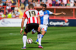 Oliver Norburn of Bristol Rovers is challenged by John O'Flynn of Exeter City - Photo mandatory by-line: Rogan Thomson/JMP - Tel: Mobile: 07966 386802 03/08/2013 - SPORT - FOOTBALL - St James Park - Exeter -  Exeter City v Bristol Rovers - Sky Bet League 2