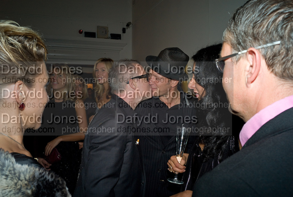 DAMIEN HIRST; PAUL SIMONON, Damien Hirst party to preview his exhibition at Sotheby's. New Bond St. London. 12 September 2008 *** Local Caption *** -DO NOT ARCHIVE-© Copyright Photograph by Dafydd Jones. 248 Clapham Rd. London SW9 0PZ. Tel 0207 820 0771. www.dafjones.com.