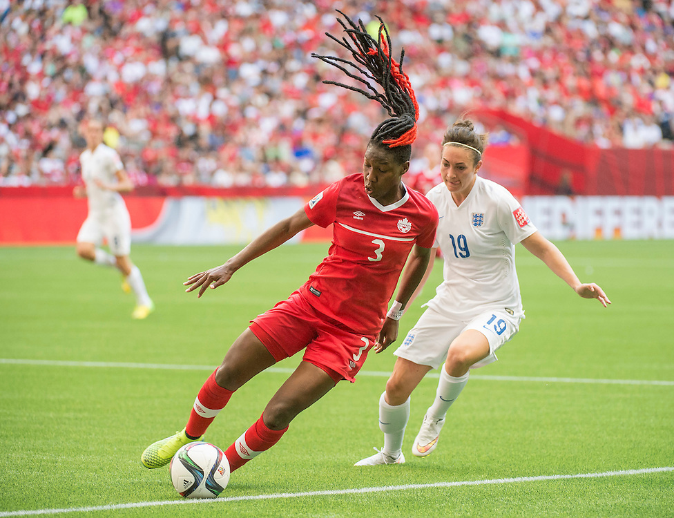 Kadeisha Buchanan of team Canada and Jodie Taylor of team England during 2015 women's World Cup Soccer in Vancouver during quarter-final action between England and Canada.