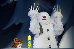 30/11/2011. London, UK. London's favourite family Christmas show based on Raymond Briggs' book The Snowman and featuring Howard Blake's much-loved score returns to the West End's Peacock Theatre for a record-breaking 14th consecutive year. Picture shows James Leece as the Snowman & Charlie Salsen as The Boy. Photo credit : Tony Nandi/LNP