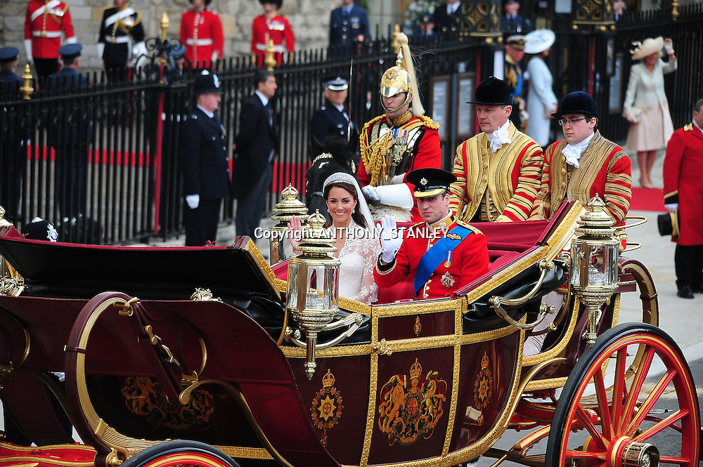 LONDON, ENGLAND - APRIL 29:Their Royal Highnesses Prince William Duke of Cambridge and Catherine Duchess of Cambridge make the journey by carriage procession to Buckingham Palace following their marriage at Westminster Abbey on April 29, 2011 in London, England. <br /> The Wedding of Prince William and Catherine Middleton - London, England - 29.04.11<br /> Mandatory Credit: &copy; ATP Anthony Stanley