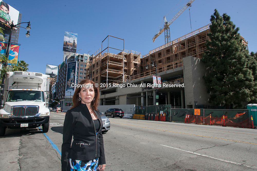 Jocelyn Topolski, the Director of Business Development at Bernards Brothers Inc., photographed in front of the construction site on the corner of Selma Ave and Argyle Ave in Hollywood<br /> (Photo by Ringo Chiu/PHOTOFORMULA.com)