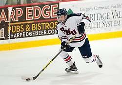 March 11 2016: Robert Morris Colonials defenseman Chase Golightly (4) skates with the puck during the first period in game one of the Atlantic Hockey quarterfinals series between the Bentley Falcons and the Robert Morris Colonials at the 84 Lumber Arena in Neville Island, Pennsylvania (Photo by Justin Berl)