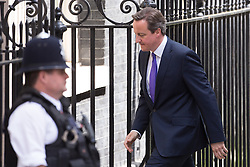 © Licensed to London News Pictures . 11/05/2015 . London , UK . The British Prime Minister , DAVID CAMERON , returns to 10 Downing Street from Parliament this afternoon (11th May 2015) . Photo credit : Joel Goodman/LNP