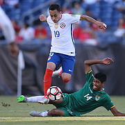 FOXBOROUGH, MASSACHUSETTS - JUNE 10:  Fabian Orellana #19 of Chile avoids the challenge of Raul Castro #14 of Bolivia during the Chile Vs Bolivia Group D match of the Copa America Centenario USA 2016 Tournament at Gillette Stadium on June 10, 2016 in Foxborough, Massachusetts. (Photo by Tim Clayton/Corbis via Getty Images)