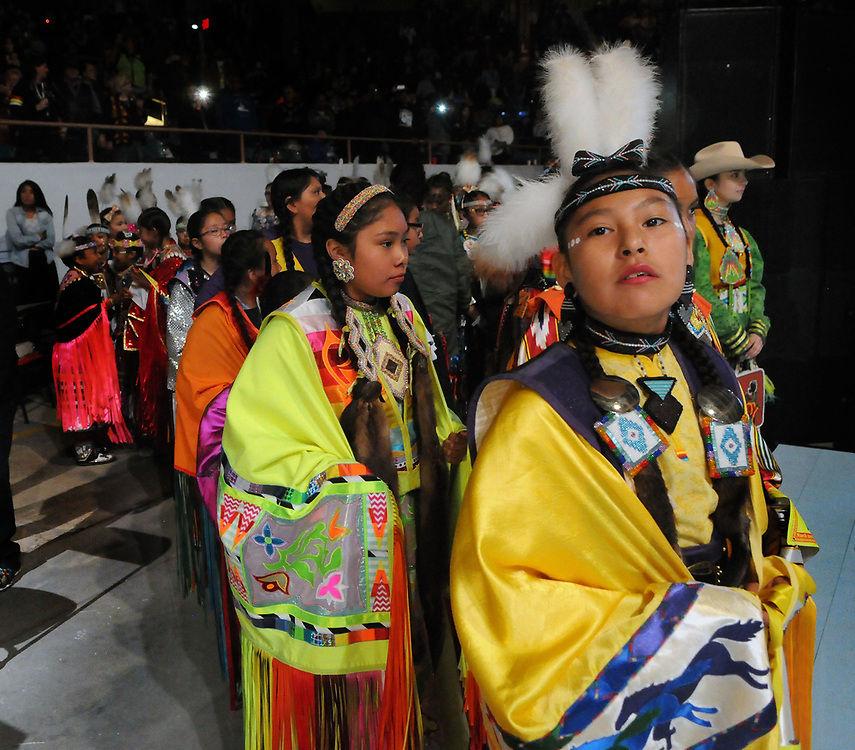 jt042817t/a sec/jim thompson/ A group of young fancy shaw dancers prepare to take to the floor of Tingley Coliseum for the Grand Entrance at the start of the 2017 Gathering of Nations Pow-Pow.  Friday April 28, 2017. (Jim Thompson/Albuquerque Journal)