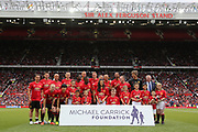 Manchester United 08 XI line up in front of the Sir Alex Ferguson stand during the Michael Carrick Testimonial Match between Manchester United 2008 XI and Michael Carrick All-Star XI at Old Trafford, Manchester, England on 4 June 2017. Photo by Phil Duncan.