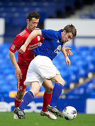 LIVERPOOL, ENGLAND - Tuesday, March 6, 2012: Liverpool's Kristzian Adorjan in action against Everton's Seamus Coleman during the FA Premier Reserve League match at Goodison Park. (Pic by David Rawcliffe/Propaganda)