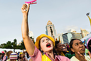 04 AUGUST 2013 - BANGKOK, THAILAND: A woman shouts slogans during an anti-government rally in Bangkok. About 2,000 people, members of the  People's Army against Thaksin Regime, a new anti-government group, protested in Lumpini Park in central Bangkok. The protest was peaceful but more militant protests are expected later in the week when the Parliament is expected to debate an amnesty bill which could allow Thaksin Shinawatra, the exiled former Prime Minister, to return to Thailand.     PHOTO BY JACK KURTZ