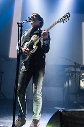 © Licensed to London News Pictures. 14/03/2014. London, UK.   Franz Ferdinand performing live at The Roundhouse.  In this picture - Nick McCarthy. Franz Ferdinand are a Scottish indie rock band composed of Alex Kapranos (lead vocals and guitar, keyboard), Bob Hardy (bass guitar), Nick McCarthy (rhythm guitar, keyboards and backing vocals), and Paul Thomson (drums, percussion and backing vocals). Photo credit : Richard Isaac/LNP