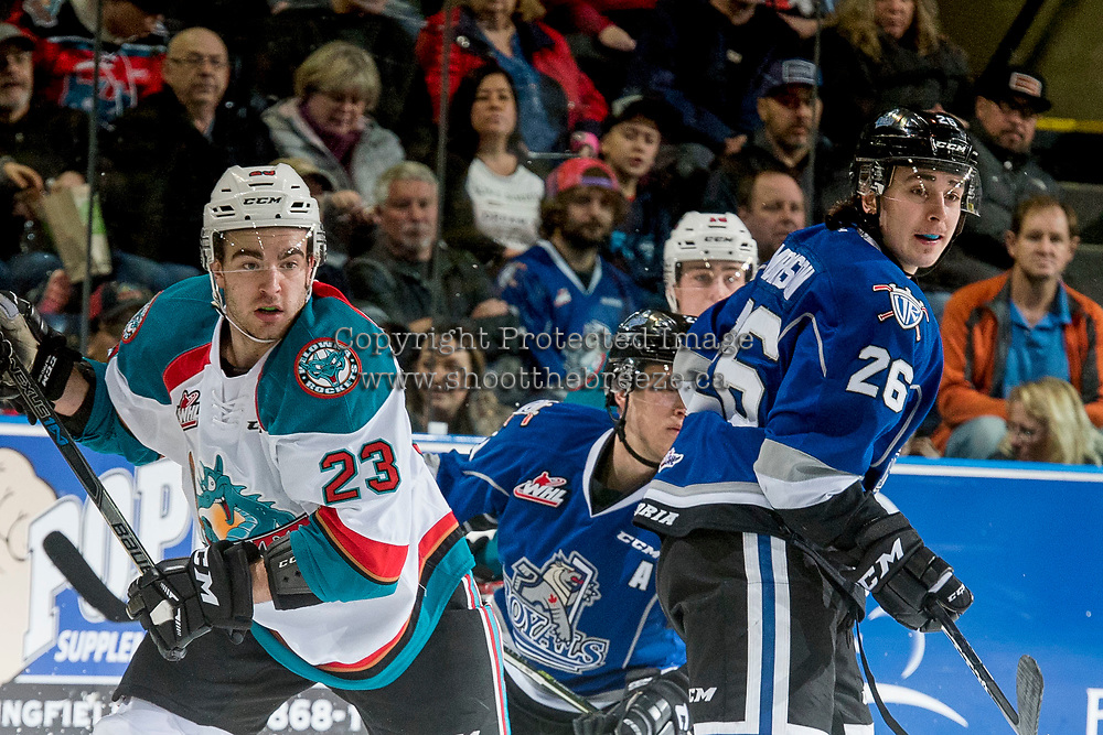KELOWNA, CANADA - MARCH 11: Reid Gardiner #23 of the Kelowna Rockets is back checked by Loch Morrison #26 of the Victoria Royals on March 11, 2017 at Prospera Place in Kelowna, British Columbia, Canada.  (Photo by Marissa Baecker/Shoot the Breeze)  *** Local Caption ***
