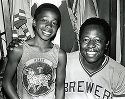 """Stanley Burrell (AK M.C. Hammer) with slugger Hank Aaron. Players called Burrell """"little Hammer"""" because of his look-alike. Burrell went on to entertainment  career as M. C. Hammer. (photo 1975 copyright Ron Riesterer)"""