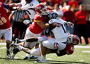 John David Baker (17) of the Abilene Christian Wildcats is sacked by Nate Dreiling (11) and Deron Washington (45) of the Pittsburg Gorillas during Saturday's football game at Carnie Smith Stadium on October 5, 2013 in Pittsburg, Kansas. (David Welker)