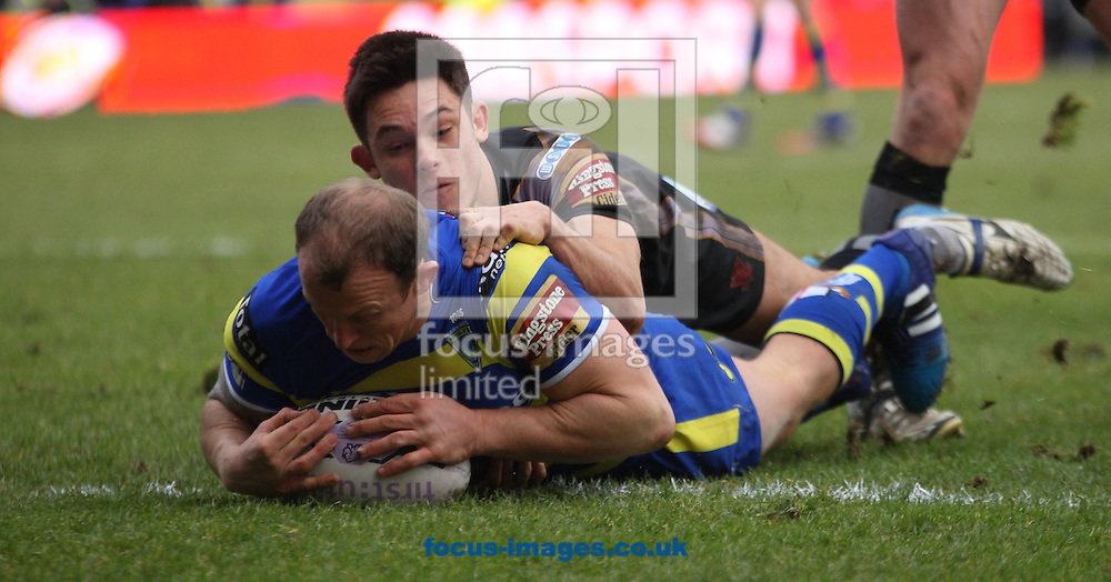 Mick Higham of Warrington Wolves  scores the 2nd try of the game against Salford Red Devils during the First Utility Super League match at the Halliwell Jones Stadium, Warrington<br /> Picture by Stephen Gaunt/Focus Images Ltd +447904 833202<br /> 07/02/2015