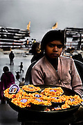 The marigolds are a flash of color amid the grim smokey business of cremation that continues day and night on the ghats in Varanasi.<br /> (Photo by Matt Considine - Images of Asia Collection)