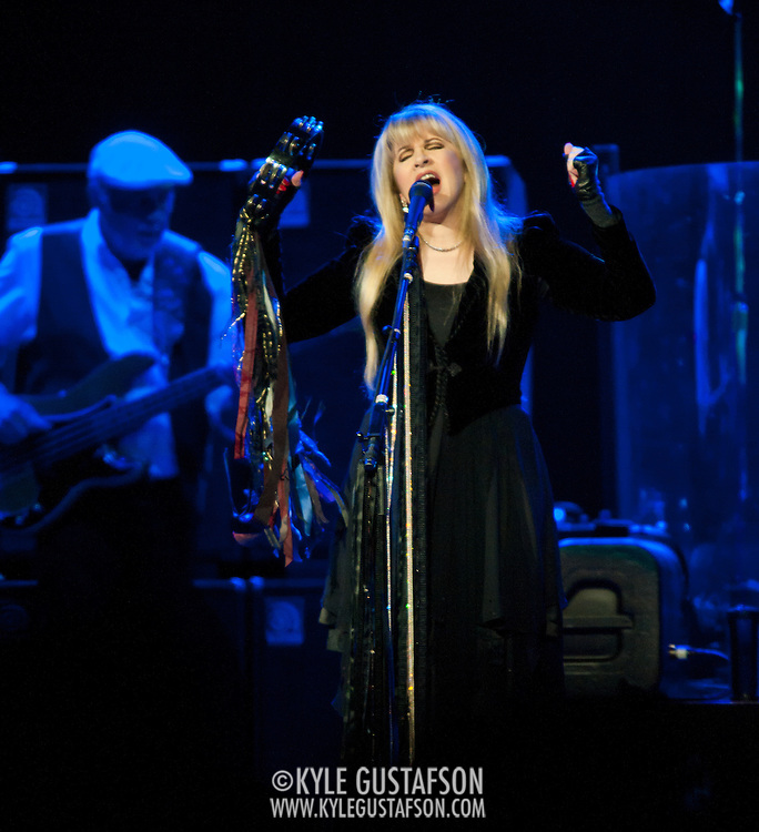 """WASHINGTON, DC - April 9th  2013 -  John McVie and Stevie Nicks of Fleetwood Mac perform at the Verizon Center in Washington, D.C. during the band's 2013 World Tour. Fleetwood Mac, touring for the first time since 2009, is including two new songs in their setlist, """"Sad Angel"""" and """"Without You."""" (Photo by Kyle Gustafson/For The Washington Post)"""