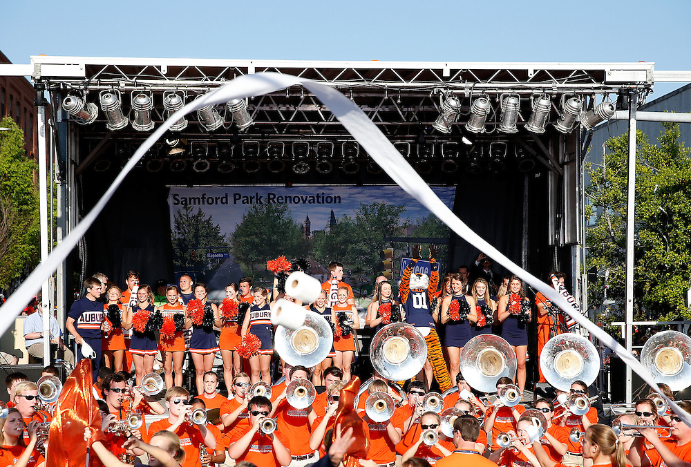 AUBURN, AL - APRIL 20:  Auburn mascot Aubie, and the Auburn University cheerleaders and band perform during the Auburn Oaks at Toomer's Corner Celebration on April 20, 2013 in Auburn, Alabama.  (Photo by Mike Zarrilli/Getty Images)