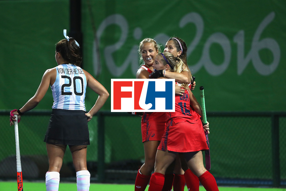 RIO DE JANEIRO, BRAZIL - AUGUST 06:  Katie Bam #16, Kelsey Kolojejchick #7, and Katie Reinprecht #14 of United States react to scoring a goal as Lucina von der Heyde #20 of Argentina looks on during a Women's Pool B match between the United States and Argentina on Day 1 of the Rio 2016 Olympic Games at the Olympic Hockey Centre on August 6, 2016 in Rio de Janeiro, Brazil.  (Photo by Sean M. Haffey/Getty Images)