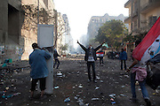A wounded young man is evacuated as Egyptian police clashed with anti-government protesters for a fifth day in central Cairo Wednesday as a rights group raised the overall death toll from the ongoing unrest to 38..The clashes came one day after tens of thousands of protesters in Tahrir Square rejected a promise by Egypt's military ruler to speed up a presidential election to the first half of next year. (Photo by Heidi Levine/Sipa Press).
