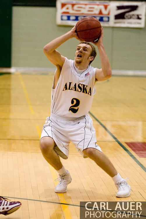 1/6/2006: Senior guard Buddy Bailey (2) of the UAA Seawolves fakes a shot as Anchorage goes on to beat the visiting Central Washington Wildcats, 80-60 at the Wells Fargo Sports Complex on the campus of UAA.<br />