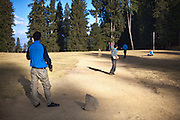 Youngsters playing cricket in a playground in a dense pine forest near Narkanda, Shimla. <br /> <br /> The place gets covered with snow in winters and used for various skiing events.