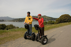 Couple on Segways, each on a Segway, on Angel Island State Park in San Francisco Bay, California, CA. Model released..Photo camari209-70402..Photo copyright Lee Foster, www.fostertravel.com, 510-549-2202, lee@fostertravel.com.