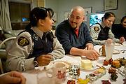 The Melanson family (Peter and Pauline and kids) have Thanksgiving dinner with his parents at their house in Iqaluit. Pauline is a member of the Royal Canadian Mounted Police, and Peter works as a senior informatics technician for the Nunavut government. Because Pauline works for the RCMP they get subsidized housing in the community in which she works: the island community of Iglulit for 2.5 years and now Iqaluit, the largest concentration of people in the territory of Nunavut. The image is part of a collection of images and documentation for Hungry Planet 2, a continuation of work done after publication of the book project Hungry Planet: What the World Eats, by Peter Menzel & Faith D'Aluisio.