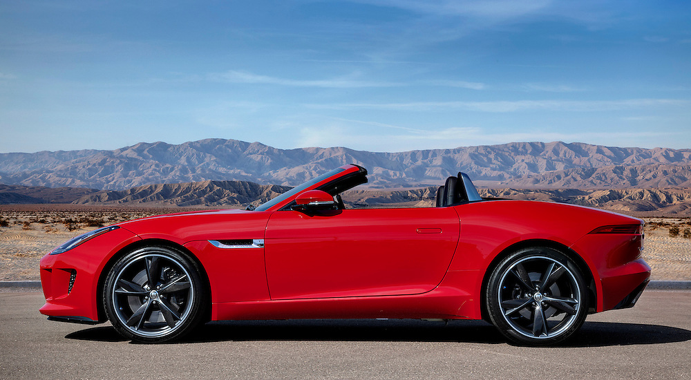 Profile of a red 2014 Jaguar F-Type photographed in the Desert of Palm Springs, CA