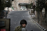 An Israeli soldier looks behind him during clashes in the West Bank city of Hebron, Monday, Feb. 22, 2010. Palestinians clashed with Israeli troops in Hebron amid outrage over Israel's plan to restore two flashpoint Jewish holy sites in the occupied territory.