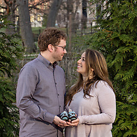 Outdoor maternity portraits with baby shoes at Shaw Park in Clayton, MO.