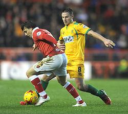 Bristol City's Luke Freeman is tackled by Yeovil Town's James Berrett - Photo mandatory by-line: Dougie Allward/JMP - Mobile: 07966 386802 - 26/12/2014 - SPORT - football - Bristol - Ashton Gate - Bristol City v Yeovil Town - Sky Bet League One