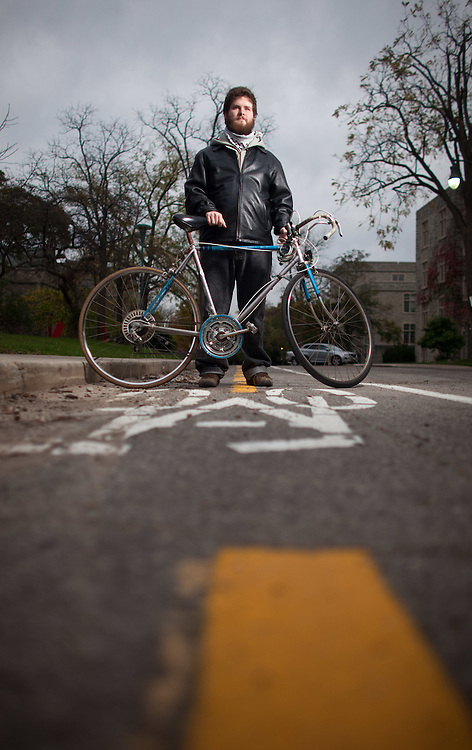 London, Ontario ---11-10-18--- University of Western Ontario graduate student Jonathan Giles doesn't see the need for a car. He is happy walking or riding his bike.<br /> GEOFF ROBINS The Globe and Mail