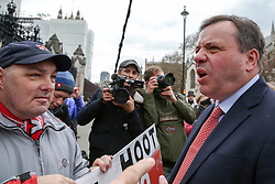 © Licensed to London News Pictures. 27/03/2019. London, UK. British businessman, Arron Banks is confronted by pro-Brexit protesters outside Houses of Parliament. Later today the MPs will votes on series of indicative votes on alternatives to Prime Minister Theresa May's Brexit deal. Photo credit: Dinendra Haria/LNP