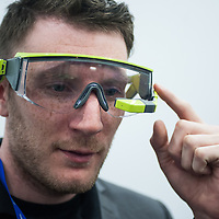 London, UK - 17 March 2014:  a man wears Kopin 102 smart glasses at the Wearable Technology Conference at Olympia in London